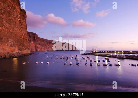 Fishing boats in the fishing port at dusk, beach Playa de Vueltas, Vueltas, Valle Gran Rey, La Gomera, Canary Islands, Spain - Stock Photo