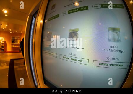 The Farmer's Fridge vending machine in Macy's Herald Square in New York on Monday, January 27, 2020. Reminiscent of the Horn & Hardart restaurants, the machine sells healthy meals and snacks such as grain bowls served in mason jars. (© Richard B. Levine) - Stock Photo