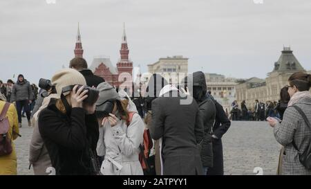 MOSCOW - MAY 27 2019: Excursion for tourists to historical places using VR helmets and virtual reality Moscow Kremlin on Red Square on May 27, 2019 in - Stock Photo