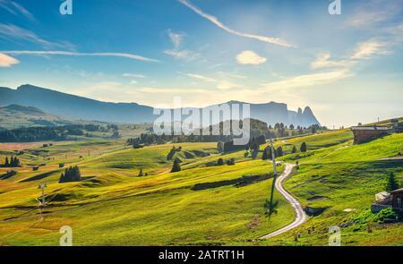 Alpe di Siusi or Seiser Alm, mountain path and Sciliar or Schlern mountain. Dolomites Alps, Trentino Alto Adige South Tyrol, Italy, Europe - Stock Photo