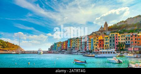 Portovenere colorful village on the sea. Boats, church and houses. Five lands, Cinque Terre, Liguria Italy Europe. - Stock Photo