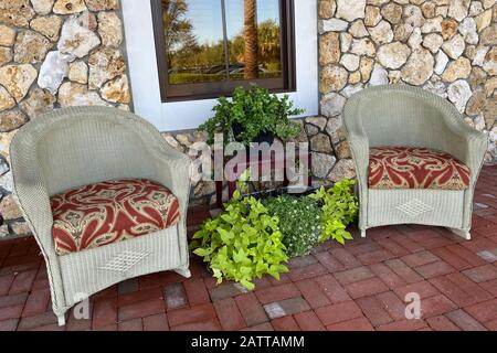 pair of southern style cobblestone porch chairs - Stock Photo