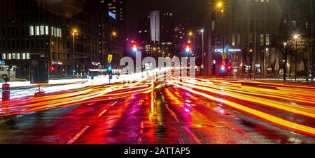 Berlin, Germany. 04th Feb, 2020. Vehicles on the Mühlendamm can only be recognised as colourful light strips. Credit: Paul Zinken/dpa/Alamy Live News - Stock Photo