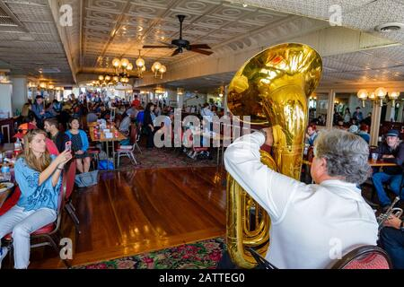 Steamboat Natchez jazz band playing for passengers on interior deck, Mississipi River, New Orleans, Louisiana, United States of America, USA - Stock Photo