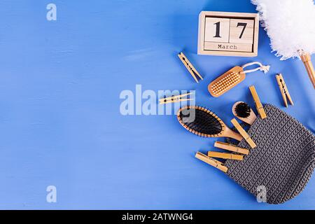Zero waste bathroom accessories of eco friendly materials, natural sisal brush, wooden comb, pin, calendar. - Stock Photo
