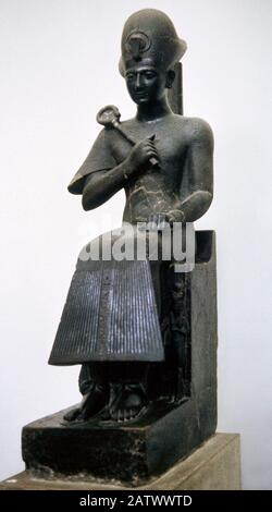Statue of Ramesses II (1279-1213 BC). Egyptian pharaoh. New Kingdom, 19th Dynasty. Diorite. From Thebes, Egypt. Egyptian Museum. Turin, Italy. - Stock Photo