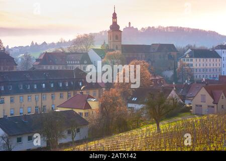 Scenic view of Old town of Bamberg, with church and vineyard at sunset, Bavaria, Upper Franconia, southern Germany - Stock Photo