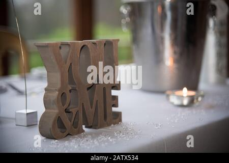 Vintage wooden You and Me love wedding sign - Stock Photo
