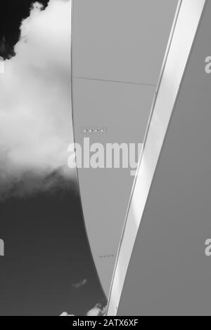Geometries of the ceiling of the office building seen from below against the background of the cloudy sky in Piazza Gae Aulenti - Milan, Italy - Stock Photo
