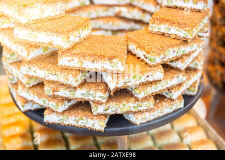 Turkish traditional dessert Kadayif  baked in syrup served with nut powder - Stock Photo