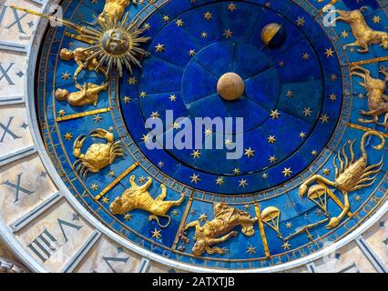 Astrological signs on ancient clock Torre dell'Orologio, Venice, Italy. Medieval Zodiac wheel and constellations. Golden symbols on star circle. Conce