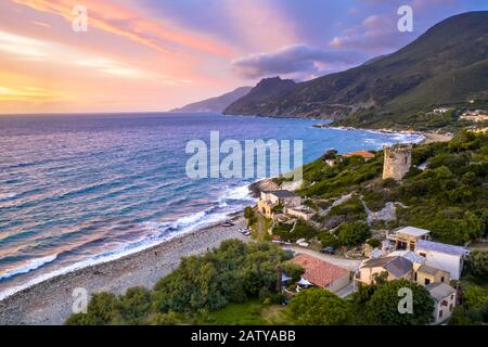 Aerial view of Corsican coast with Genoese watch tower on Cap Corse near Farinol. Corsica, France. - Stock Photo