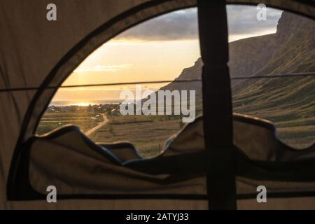 View from a roof top tent on surfer paradise Unstad on Lofoten Islands, Norway. Vanlife at its best at sunset.