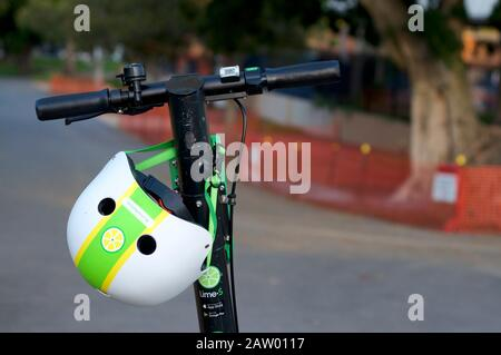 Brisbane, Queensland, Australia - 28th January 2020 : Close up of a dockless Lime e-scooter handlebars and a helmet in the city of Brisbane. This E-sc - Stock Photo