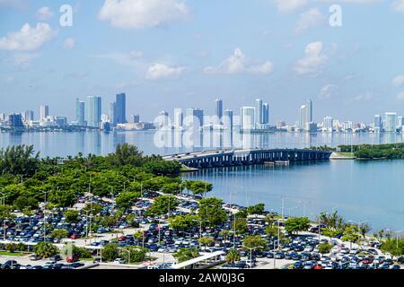 Florida, FL, South, Miami Beach, SoBe, Biscayne Bay, parking lot, cars, Julia Tuttle Causeway, skyline, high rise rises skyscraper skyscrapers tall bu