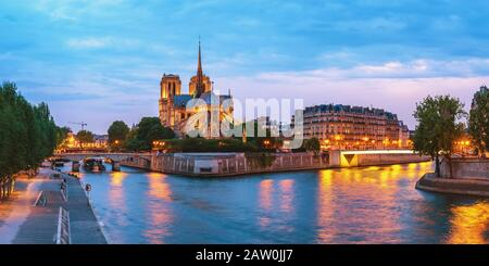 Paris France, panorama city skyline night at Notre Dame de Paris Cathedral and Seine River Stock Photo
