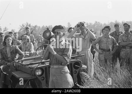 School for Training Paratroopers at Bandung (Andir)  Parachutist (lieutenant KNIL) looks through a special viewer Date: July 3, 1947 Location: Bandung, Indonesia, Java, Dutch East Indies - Stock Photo
