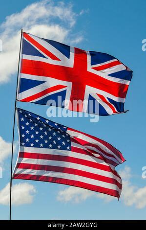 british and american flags flying together - Stock Photo