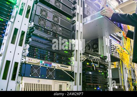 Emergency equipment replacement in the server rack. Work with computer servers in the data center. - Stock Photo