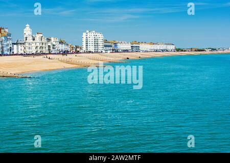 EASTBOURNE, EAST SUSSEX, UK - MAY 23 : View of Eastbourne town seafront, houses and beach from the pier in East Sussex on May 23, 2019 - Stock Photo