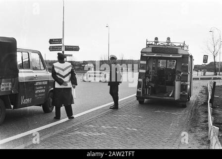 Demonstration of Belgian farmers with tractors on the road Netherlands  police station during the action of farmers Date: March 19, 1971 Location: Belgium Keywords: demonstrations, farmers, policemen - Stock Photo