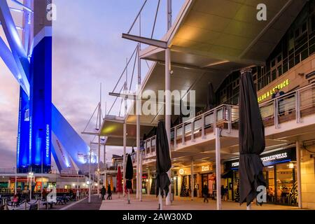 The Spinnaker Tower, shops and restaurants at night, Gunwharf Quays, Portsmouth, UK - Stock Photo