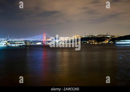 Bosporus in the night at istanbul. Bosphorus bridge and Camlica big mosque - Stock Photo