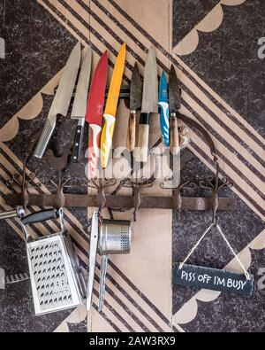 Cooking utensils on wall - Stock Photo