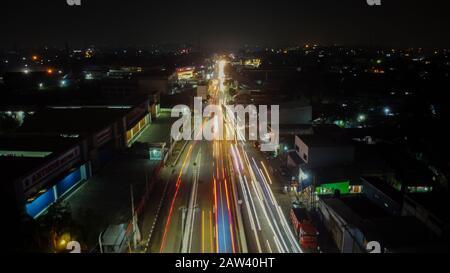 BEKASI. INDONESIA - FEBRUARY 7 2020: light trails on motorway highway at night, long exposure abstract urban background at Bekasi