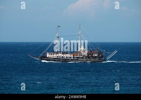 Voutirakos Cruises galleon themed pirate ship in the sea of Zakinthos Greece taking tourists on tours of the island. - Stock Photo