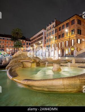 Nigh view of the Spain square and Fontana della Barcaccia, Piazza di Spagna. Rome - Stock Photo