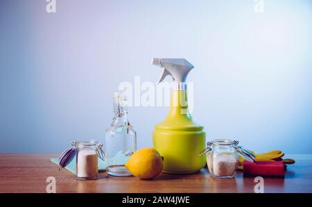 Natural cleaners concept. Natural organic eco friendly home cleaning ingredients, white vinegar, lemon, baking soda, citric acid on wood table with co - Stock Photo