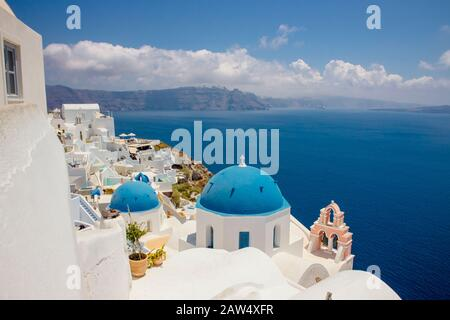Famous blue dome orthodox church in village of Oia on Santorini island in Greece in Europe.