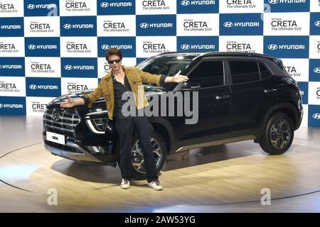 Indian Bollywood actor Shah Rukh Khan poses next to the newly launched Hyundai Creta SUV at the Auto Expo 2020 at Greater Noida. - Stock Photo