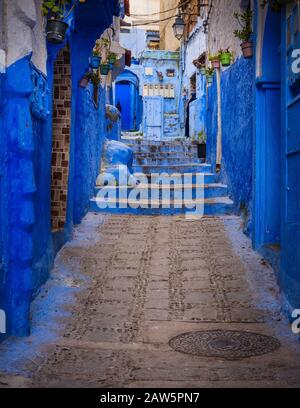 CHEFCHAOUEN, MOROCCO - CIRCA MAY 2018: Typical door of the streets of Chefchaouen - Stock Photo