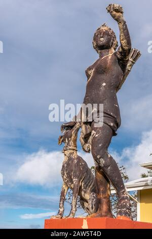 Waimea, Hawaii, USA. - January 15, 2020: Parker Ranch headquarters. Closeup of old white stone discollored by black mold statue of Diana with dog unde - Stock Photo