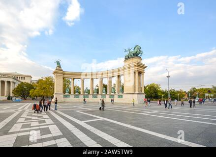Tourists and local Hungarians enjoy an afternoon on Heroes Square in Budapest, Hungary. - Stock Photo