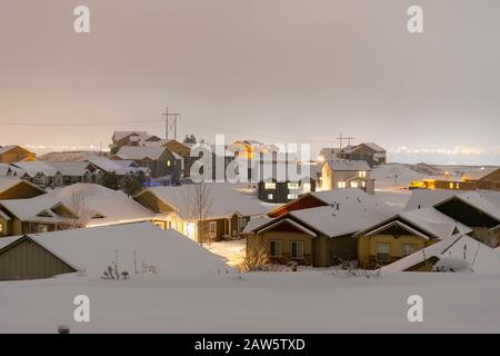 New homes being built in a hilltop subdivision in the suburbs of Spokane Washington covered in fog and snow during winter. - Stock Photo