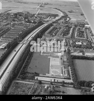 Aerial view. Outdoor swimming pool and sports complex Leiderdorp Annotation: View from the south. Left current A4 motorway. The pool is gone. Now football RKVV Meerburg Date: 1968 Location: Leiderdorp Keywords: aerial shots, pools - Stock Photo