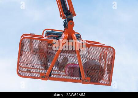 Worker on a telescopic boom lift platform - Stock Photo