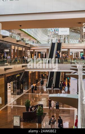 Singapore, April, 2019. Interior shot of the Shoppes at Marina Bay Sands. Marina Centre, with Marina Bay in the foreground. Marina Centre is a zone of - Stock Photo