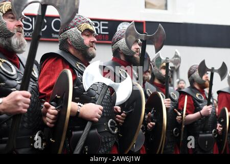 Lerwick Shetland 28th January 2020. Guizer Jarl Liam Summers representing the Norse God Odin leads his squad of guizers through the streets of Lerwick - Stock Photo