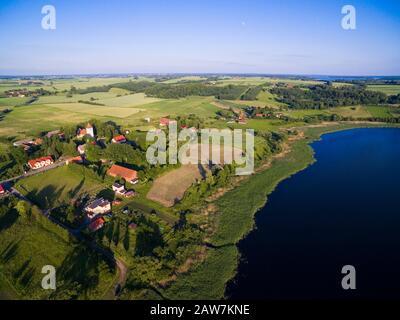 Aerial view of beautiful Wegielsztyn village (former Engelstein, East Prussia) located on Wegielsztynskie Lake shore, Mazury, Poland