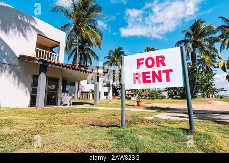House for rent. White plate with the inscription. Announcement of rooms for rent in a resort on the Caribbean coast. - Stock Photo