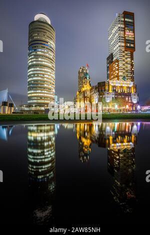 Rotterdam kop van zuid skyline at night, Hotel New York, Montevideo and Rotterdam Harbor tower buildings - Stock Photo