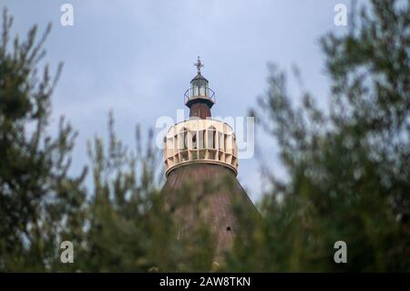 Selective focus of the cupola of the Basilica of the Annunciation as seen through olive branches, Nazareth, Galilee, Israel - Stock Photo