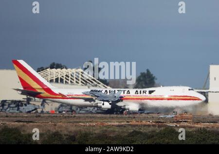 San Diego, California, USA. 7th Feb, 2020. A military F-18 takes off as a Kalitta Air 747 chartered by the U.S. State Department to evacuate Americans from the novel coronavirus outbreak in the Chinese city of Wuhan, arrives at Marine Corps Air Station Miramar in San Diego. Credit: KC Alfred/ZUMA Wire/Alamy Live News - Stock Photo