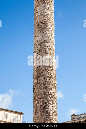 Column of Marcus Aurelius, Rome Italy. 193 AD. It stands 130 feet tall and the carvings in the 27 blocks of hollowed out Carrara marble tell the story - Stock Photo
