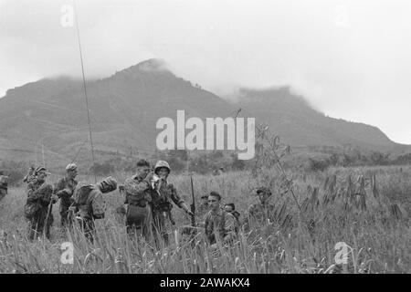 Action Bandung (1st Police Action 21-24 July 1947)  Military units in the field. Commander looks through a compass viewer Date: July 21, 1947 Location: Bandung, Indonesia, Dutch East Indies - Stock Photo