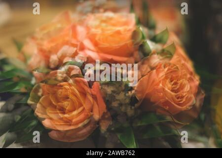 Bouquet of roses with double exposure abstract background. blurred flowers
